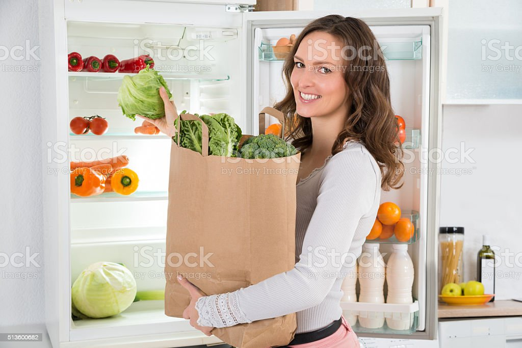 Woman Holding Shopping Bag With Vegetables stock photo