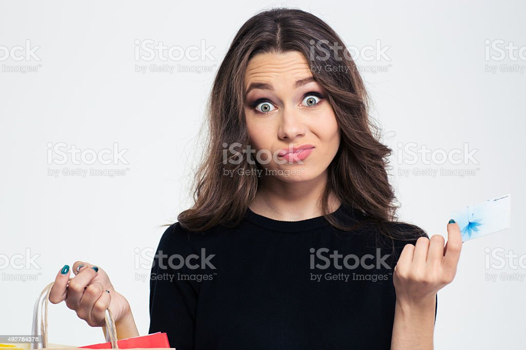 Woman holding shopping bags and bank card stock photo