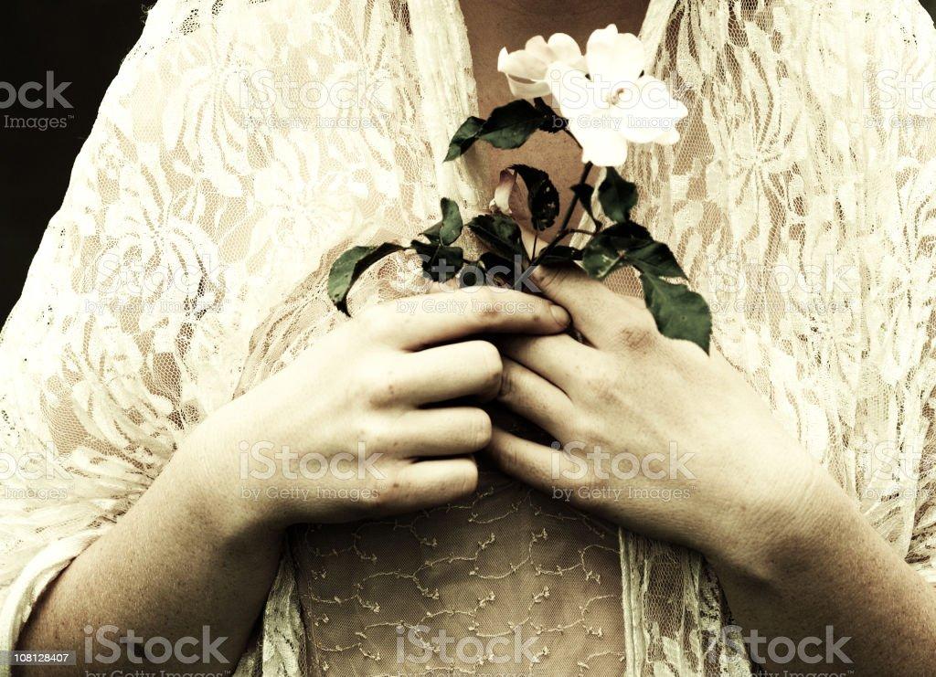 Woman Holding Single Flower royalty-free stock photo