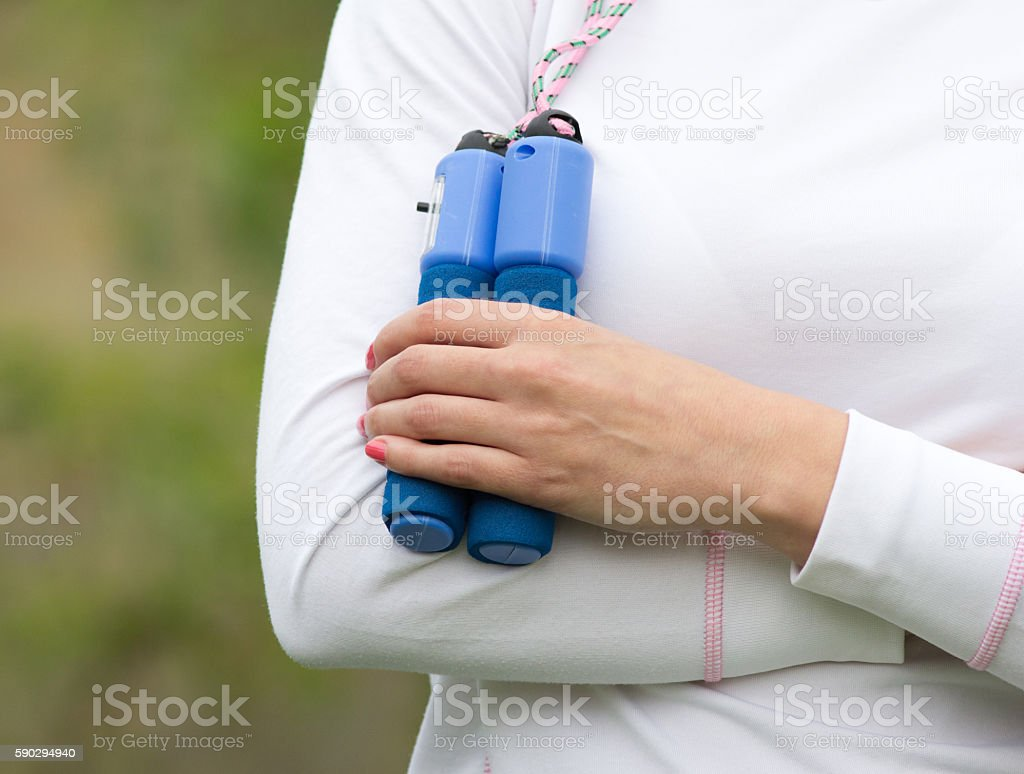 Woman holding skipping rope stock photo