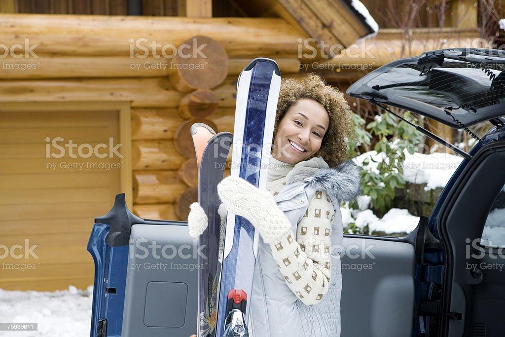 Woman holding skis royalty-free stock photo