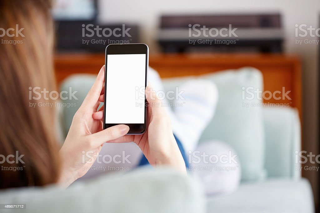 Woman holding smart phone with blank screen stock photo