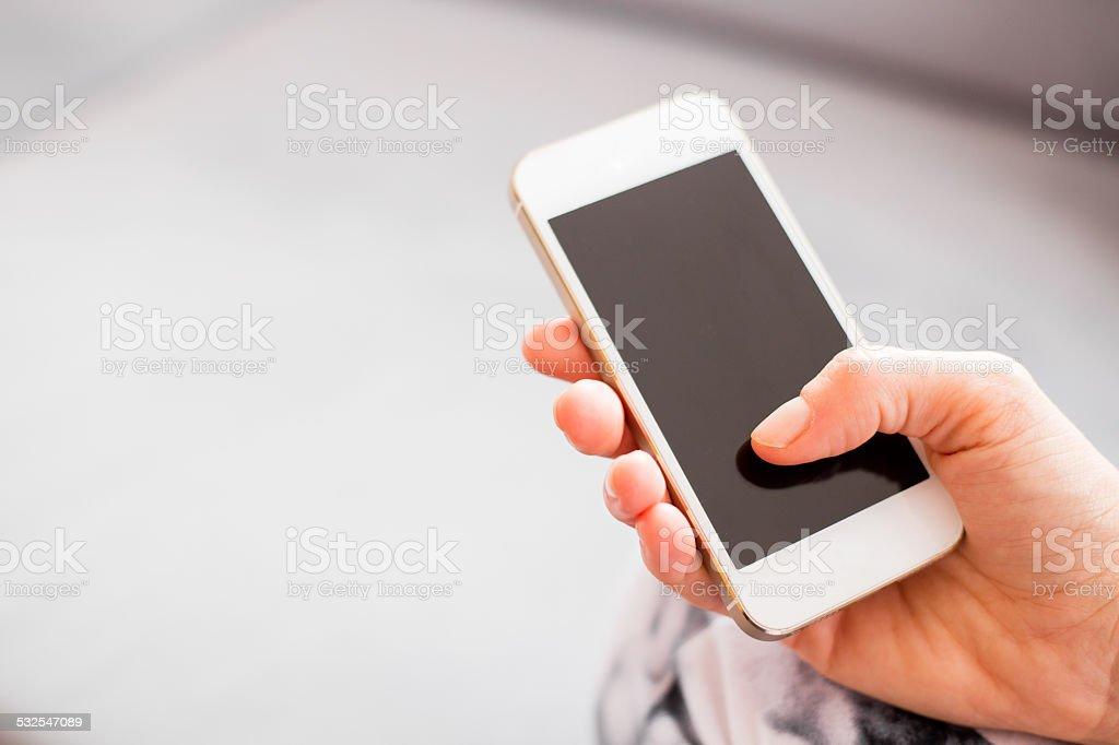 Woman holding smartphone stock photo