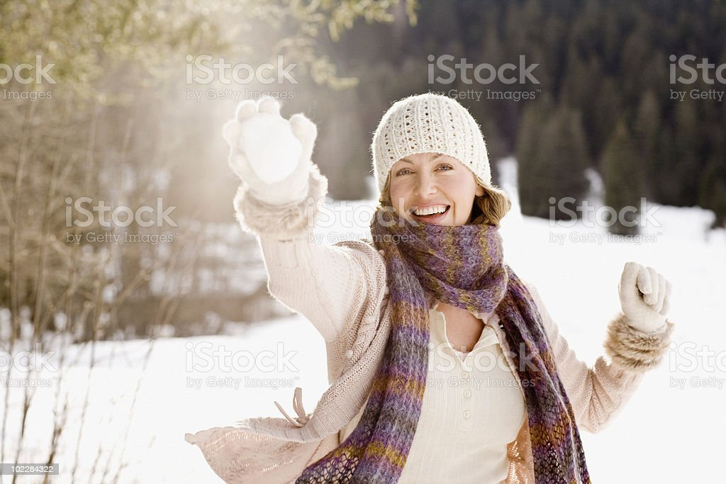 Woman holding snowball stock photo