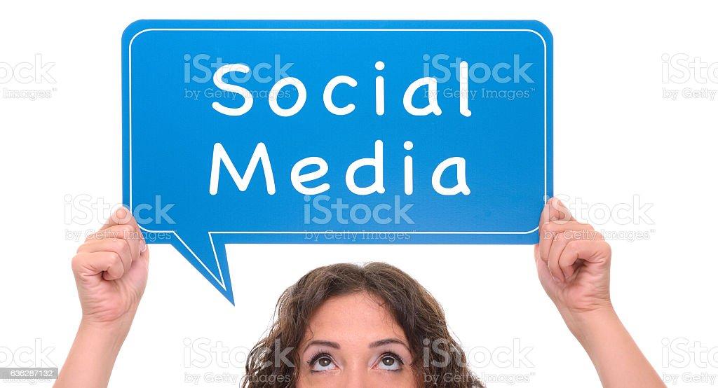 Woman holding social media sign stock photo