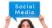 Woman holding social media sign