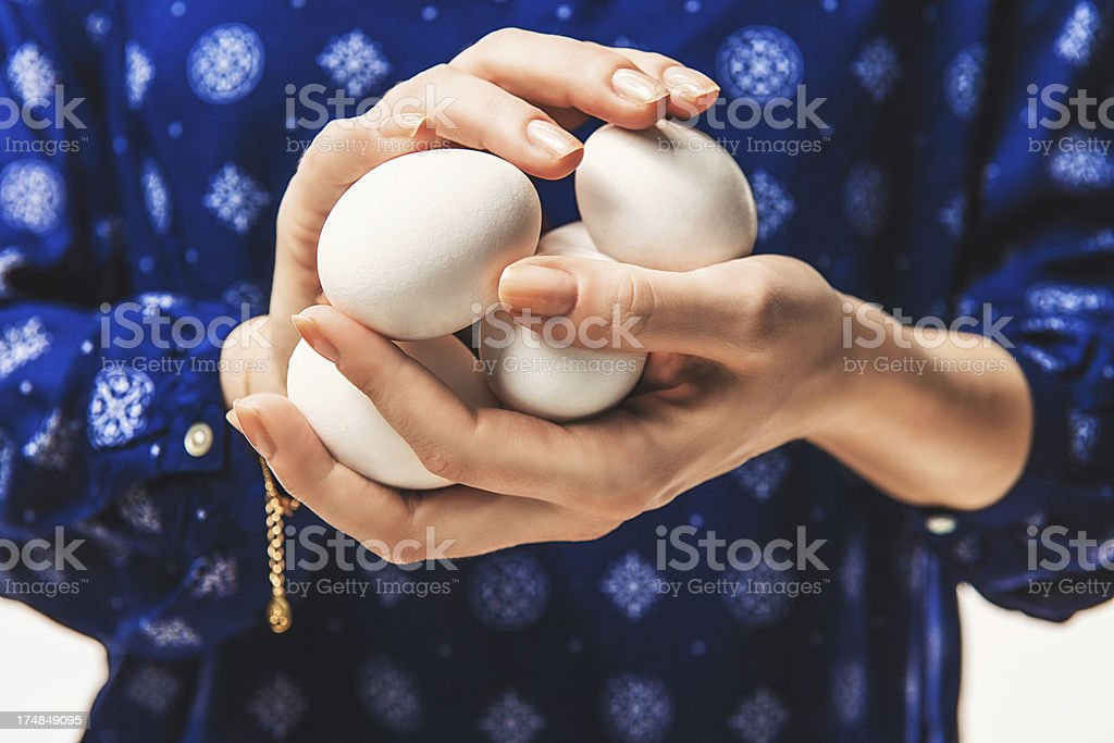 Woman holding some eggs royalty-free stock photo
