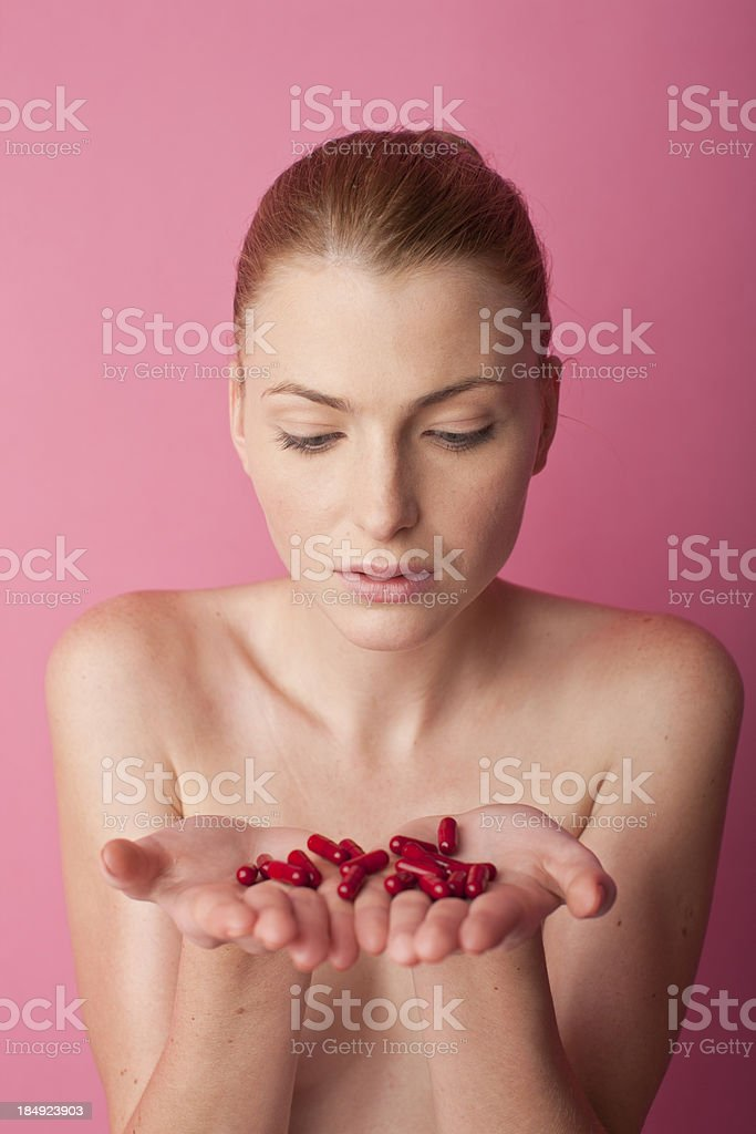 woman holding some pills royalty-free stock photo