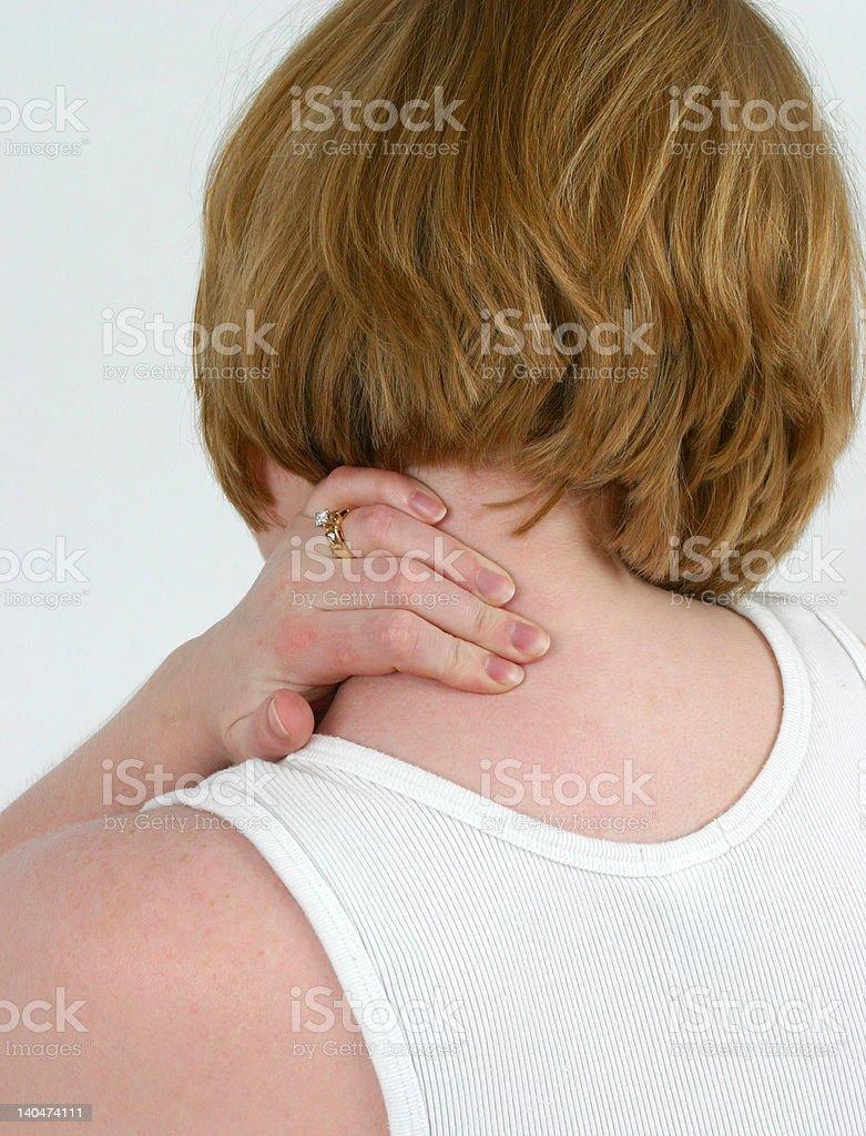 Woman holding sore neck royalty-free stock photo