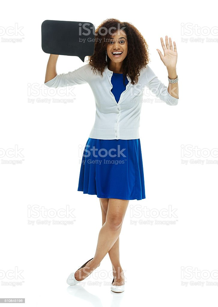 Woman holding speech bubble and waving hand stock photo