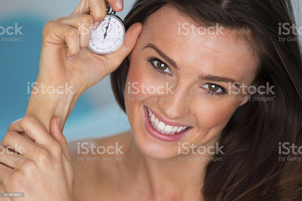 Woman Holding Stopwatch stock photo