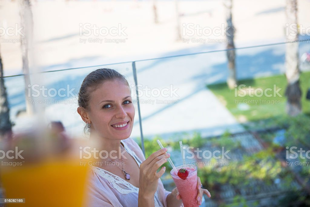 Woman holding strawberry juice stock photo