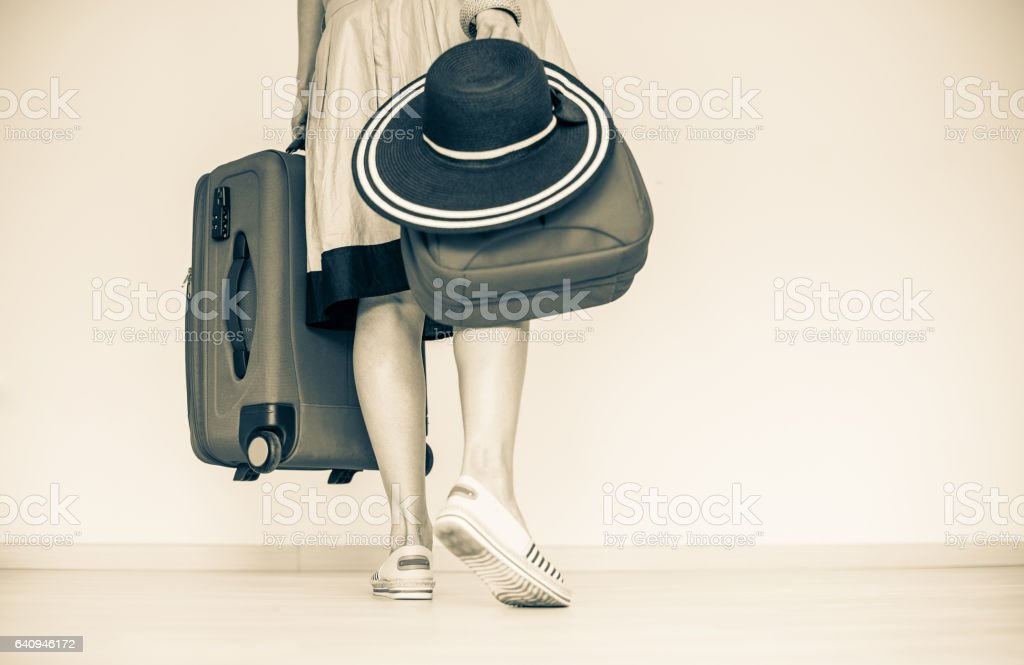 A Woman Holding Suitcase stock photo