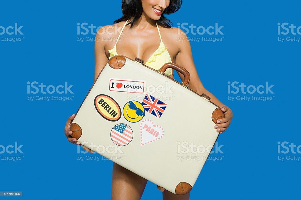 Woman holding suitcase stock photo