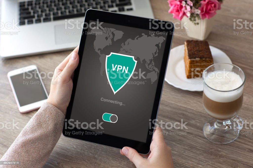 woman holding tablet app vpn creation Internet protocols protection network stock photo