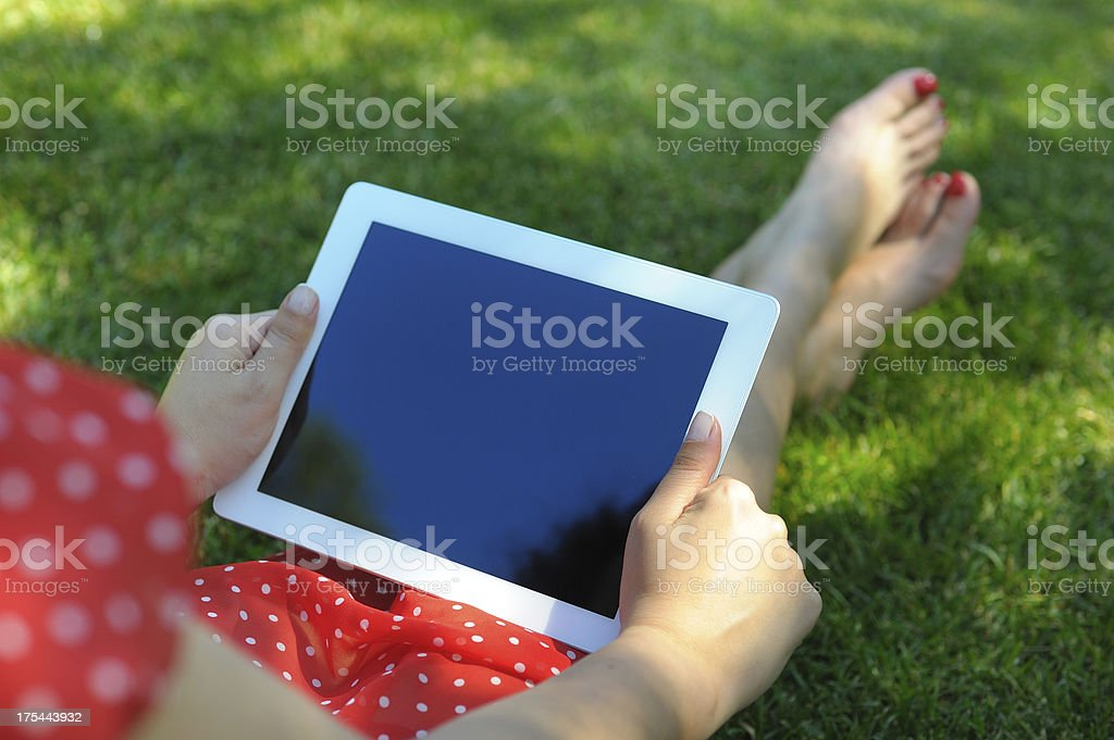 Woman holding tablet pc in nature royalty-free stock photo
