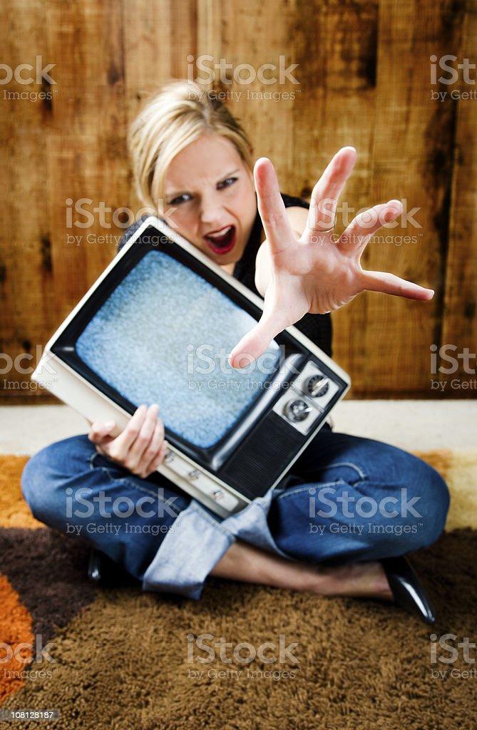 Woman holding Television and Grabbing royalty-free stock photo