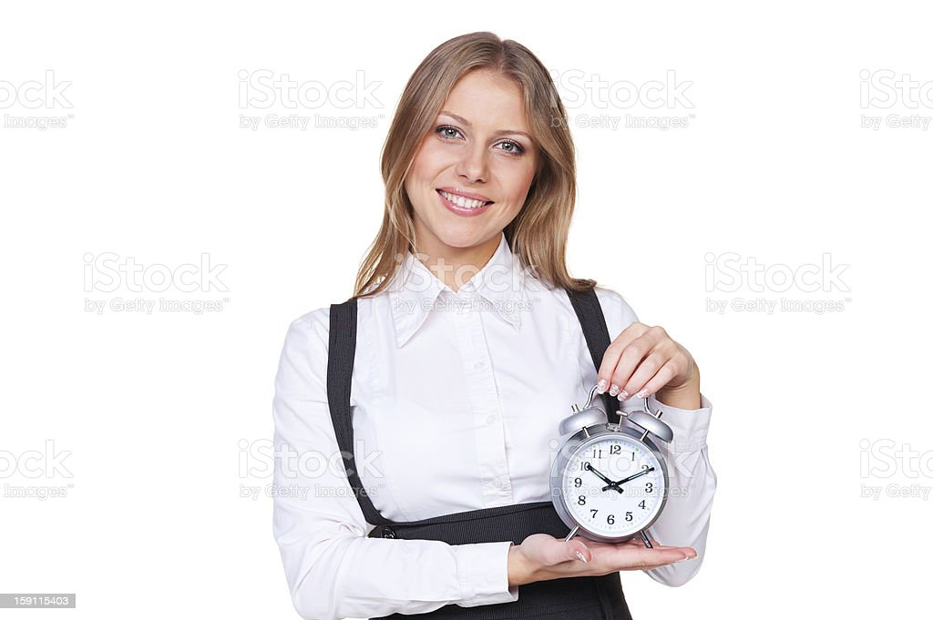 woman holding the alarm clock and looking at camera royalty-free stock photo