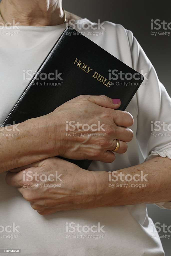 woman holding the Holy Bible royalty-free stock photo