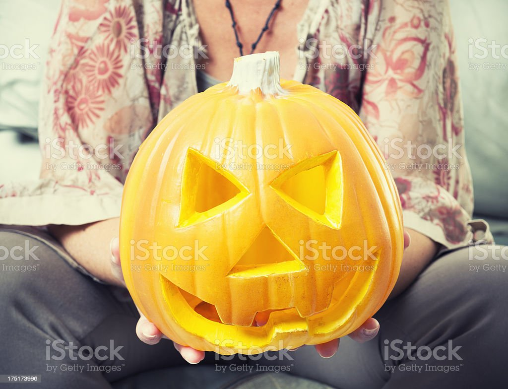 woman holding the jack O'Lantern Pumpkins - Halloween decoration royalty-free stock photo