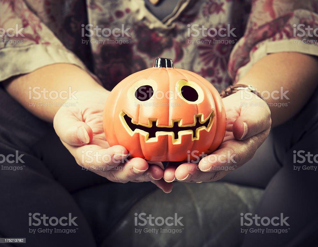 woman holding the jack O'Lantern Pumpkins - Halloween decoration royalty-free stock photo