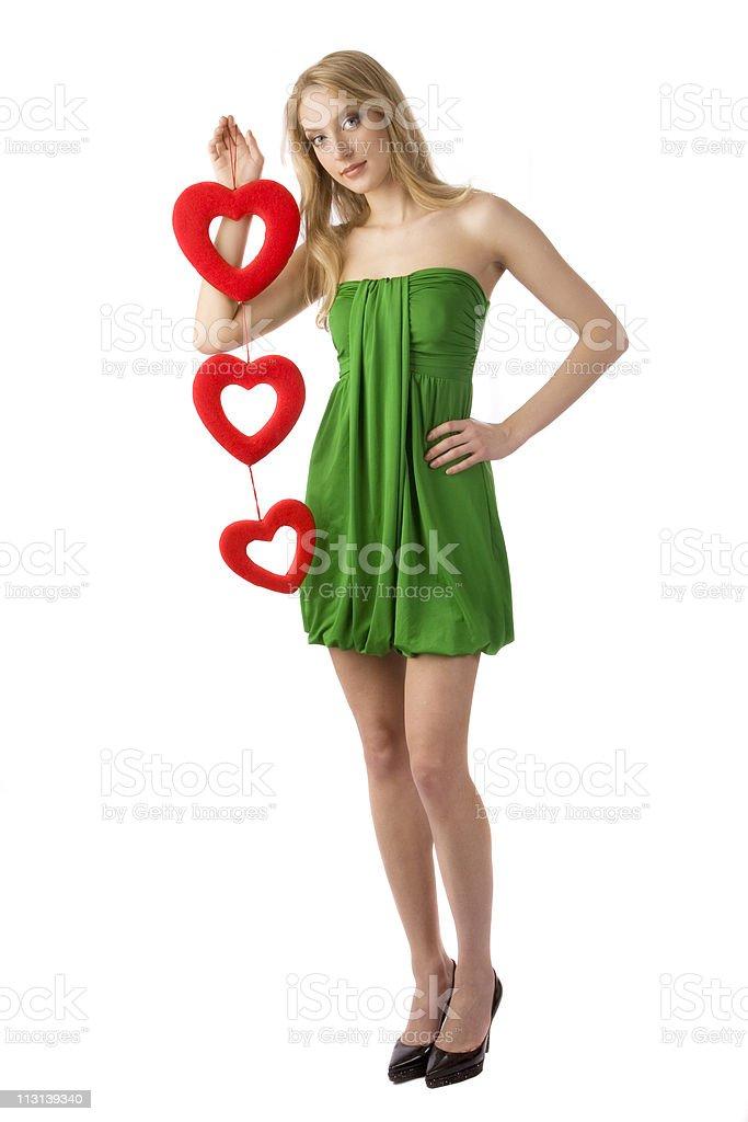 Woman holding three hearts. royalty-free stock photo