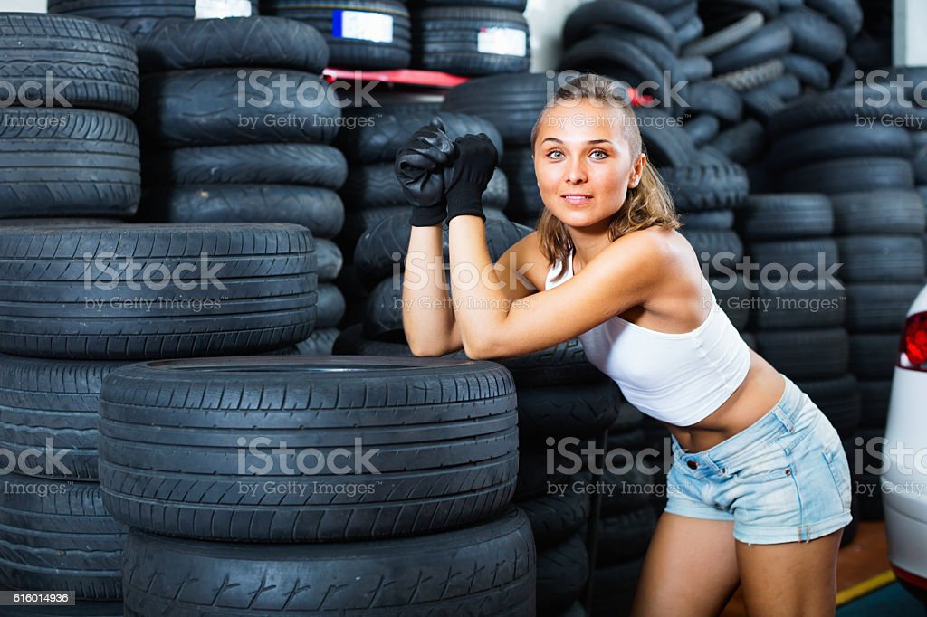 Woman holding tool in hands and working with auto stock photo