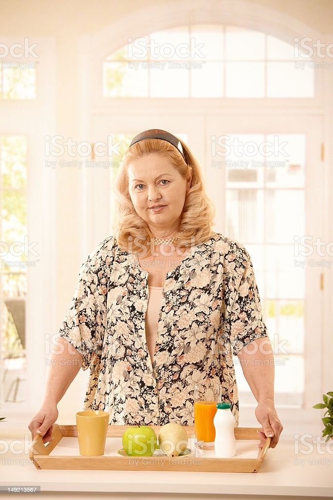 Woman holding tray with food royalty-free stock photo