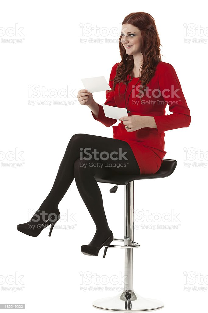 Woman holding two cards royalty-free stock photo