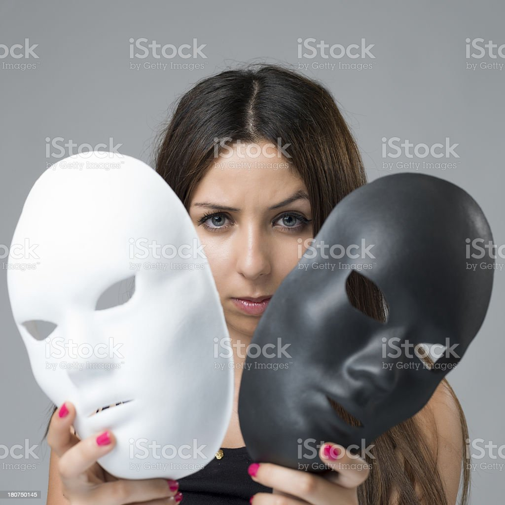 woman holding two drama masks. stock photo