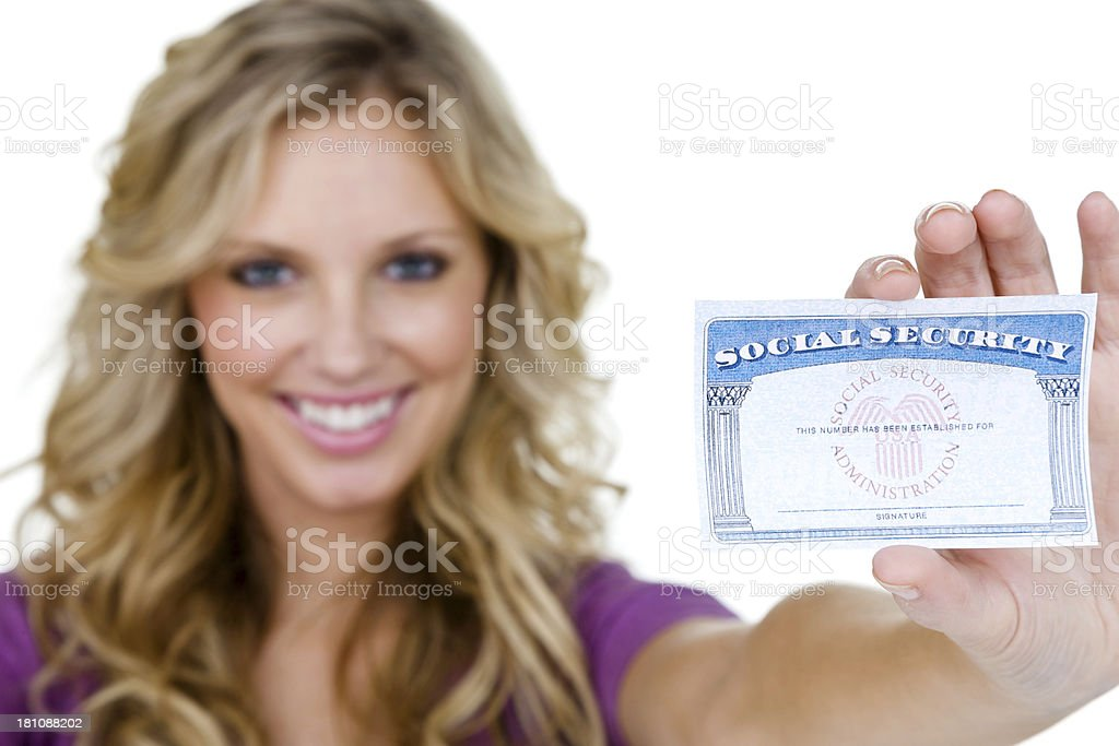Woman holding up a social security card royalty-free stock photo