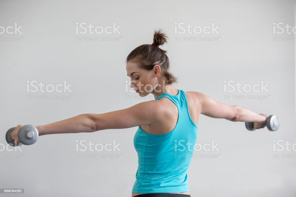 Woman Holding Up Dumbbells! stock photo