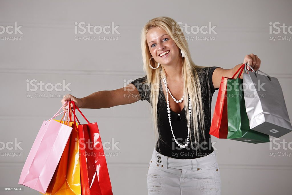 Woman holding up shopping bags royalty-free stock photo
