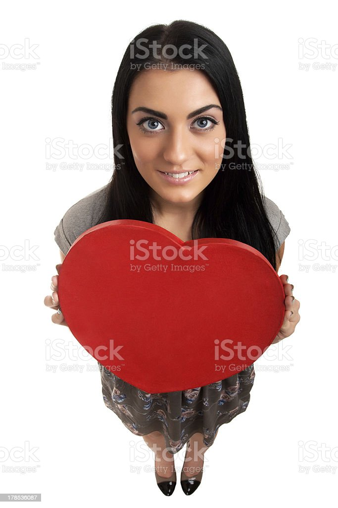 Woman holding Valentines Day heart sign royalty-free stock photo