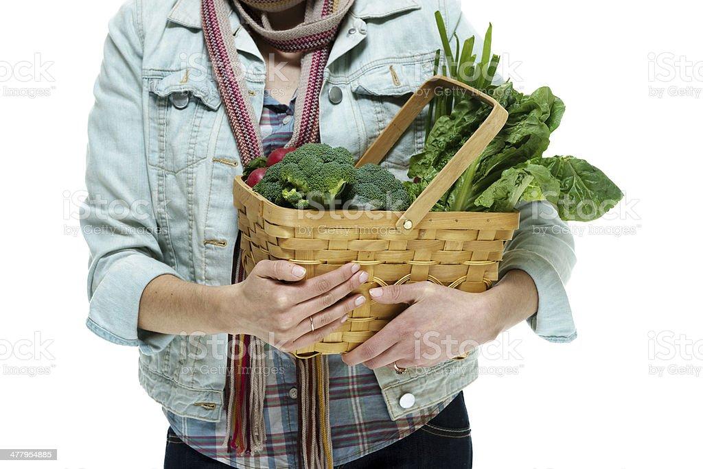 Woman holding vegetable basket stock photo
