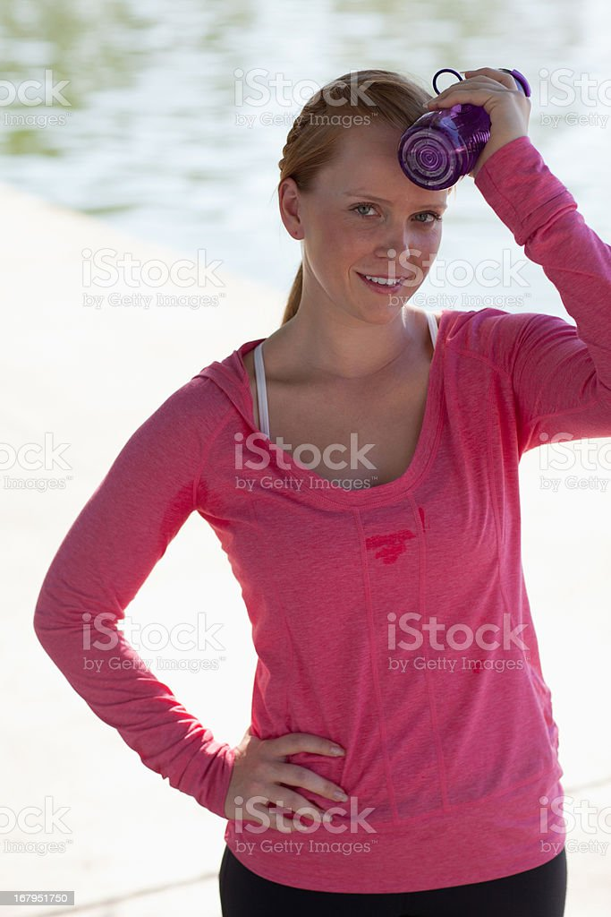 Woman holding water bottle outdoors royalty-free stock photo