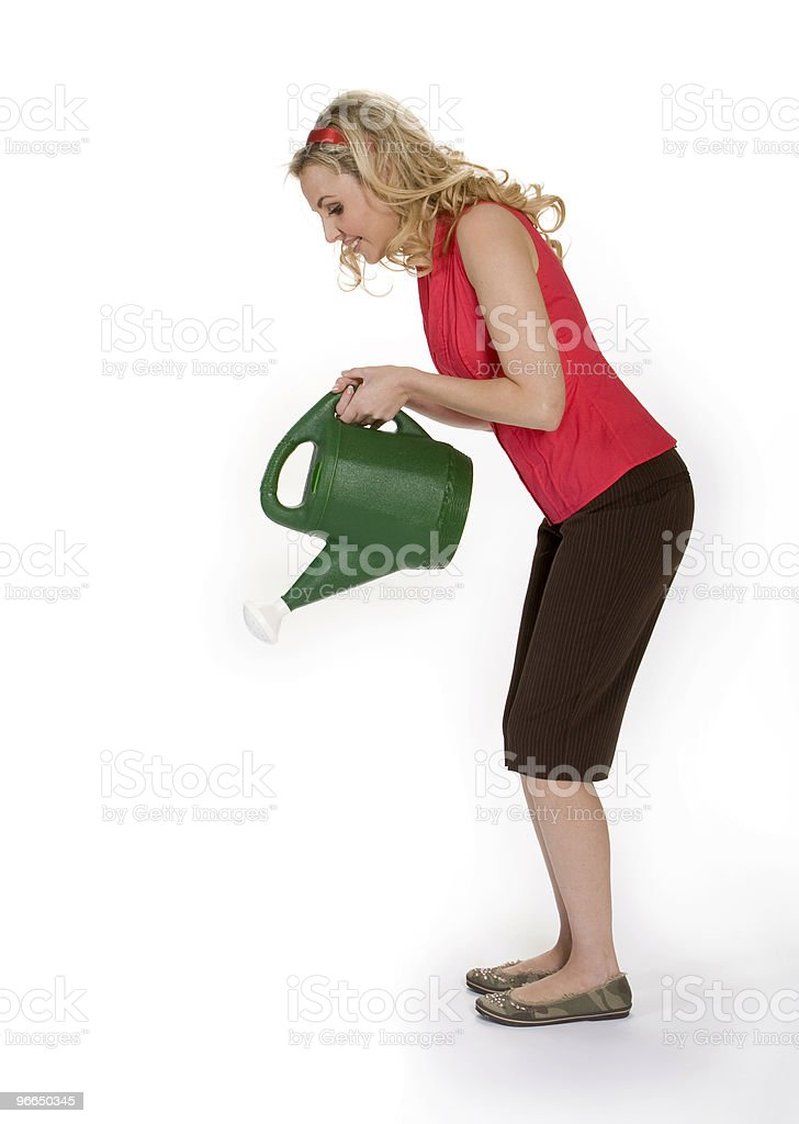 Woman Holding Watering Can stock photo