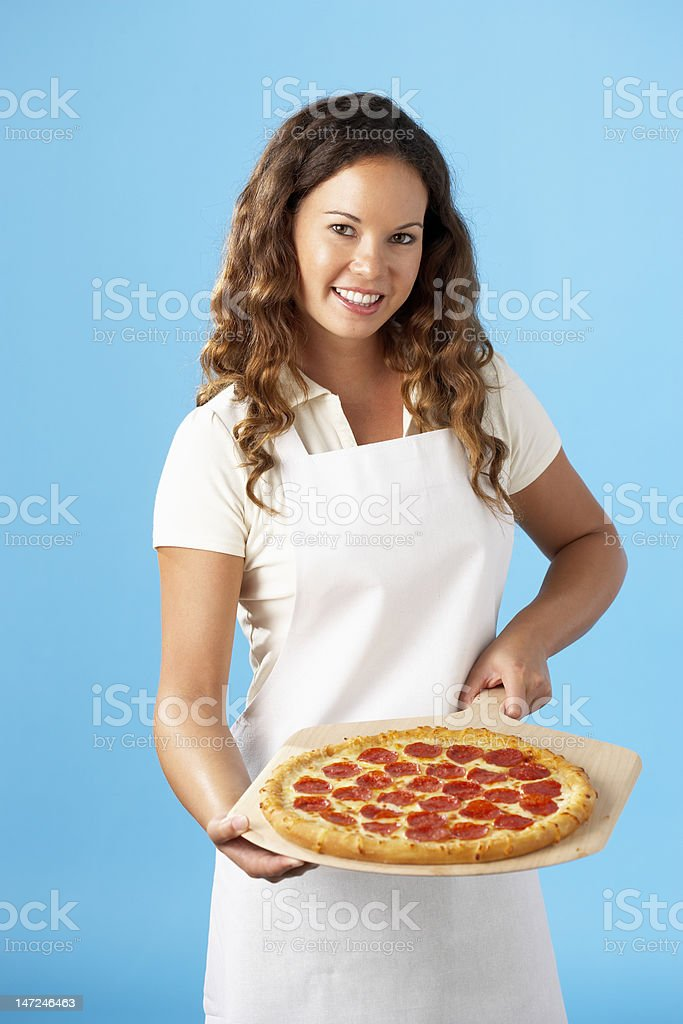 Woman holding whole Pizza stock photo