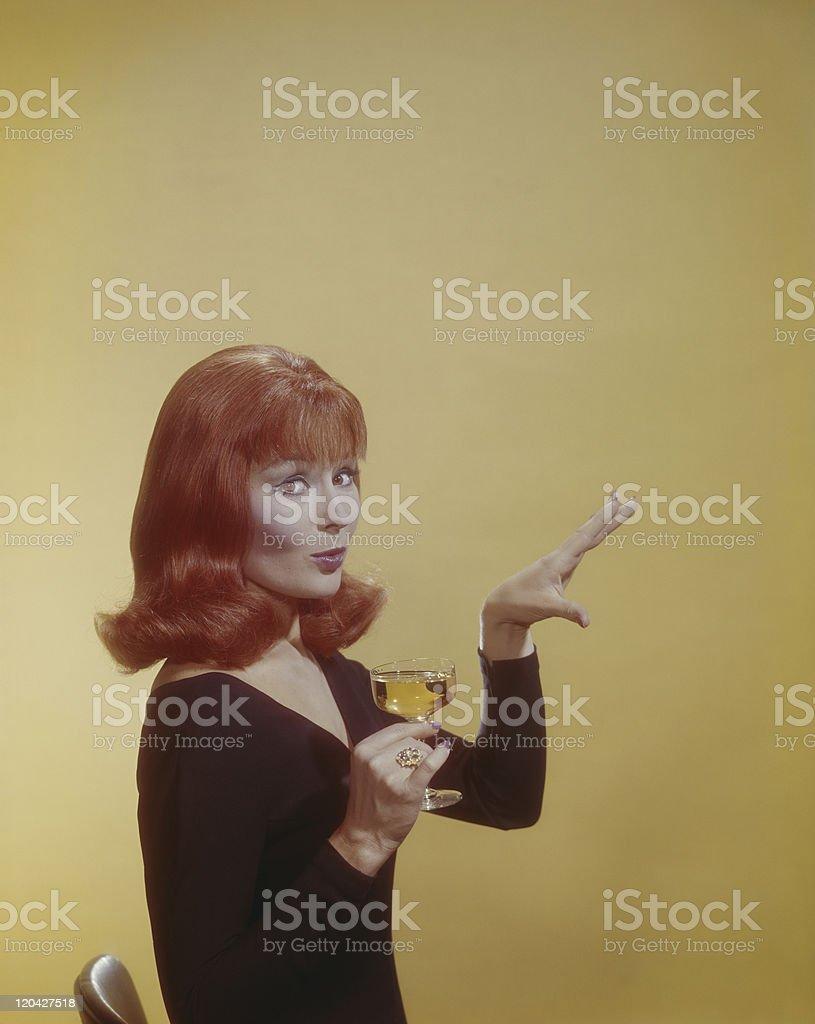Woman holding wine glass, portrait stock photo
