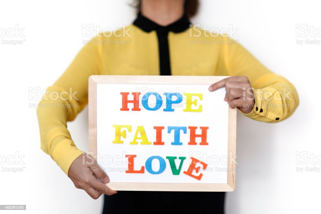 Woman holding written Hope , Faith , Love concept stock photo
