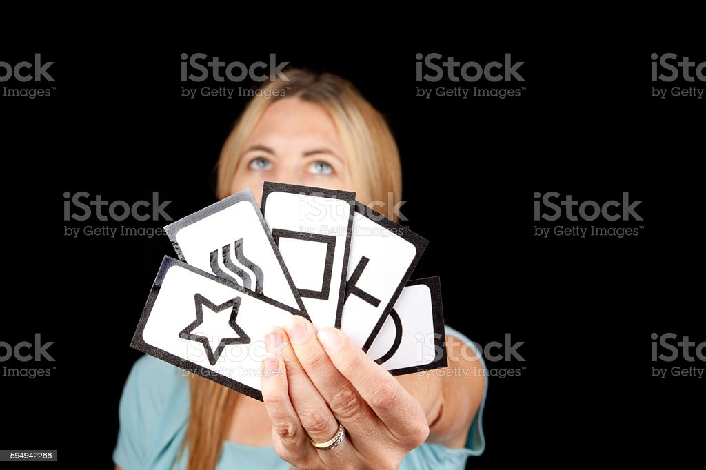 Woman Holding Zenner Cards For ESP Test stock photo