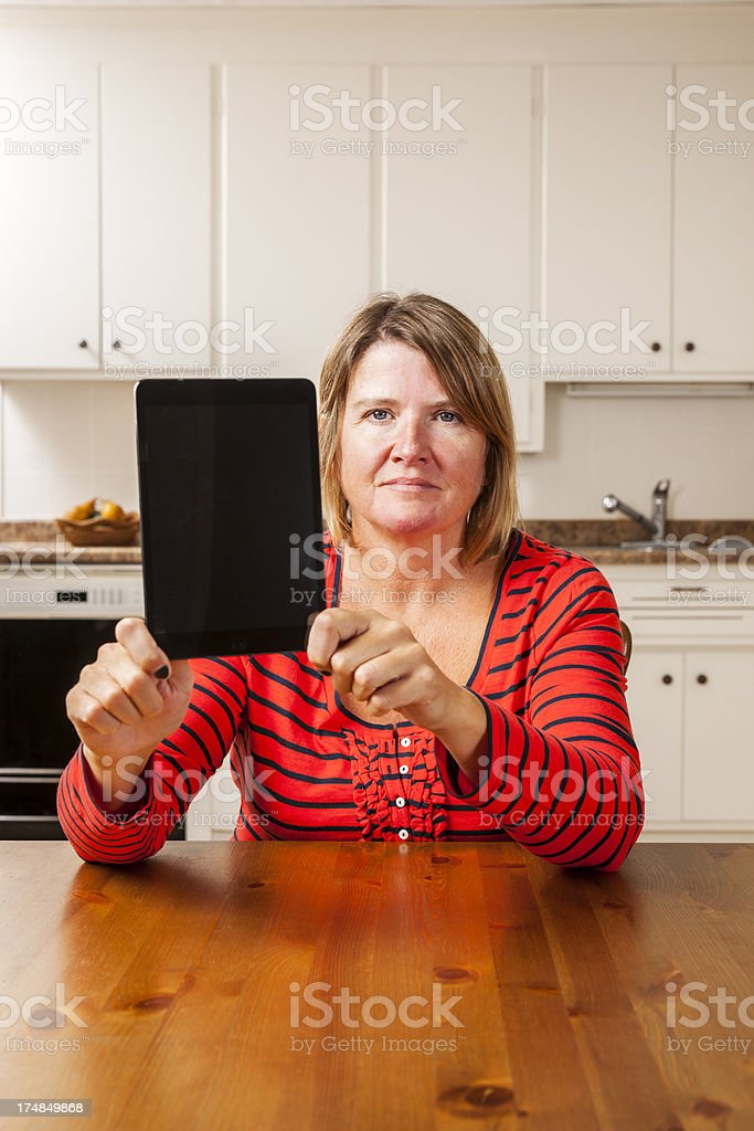 Woman holding-up a tablet computer royalty-free stock photo