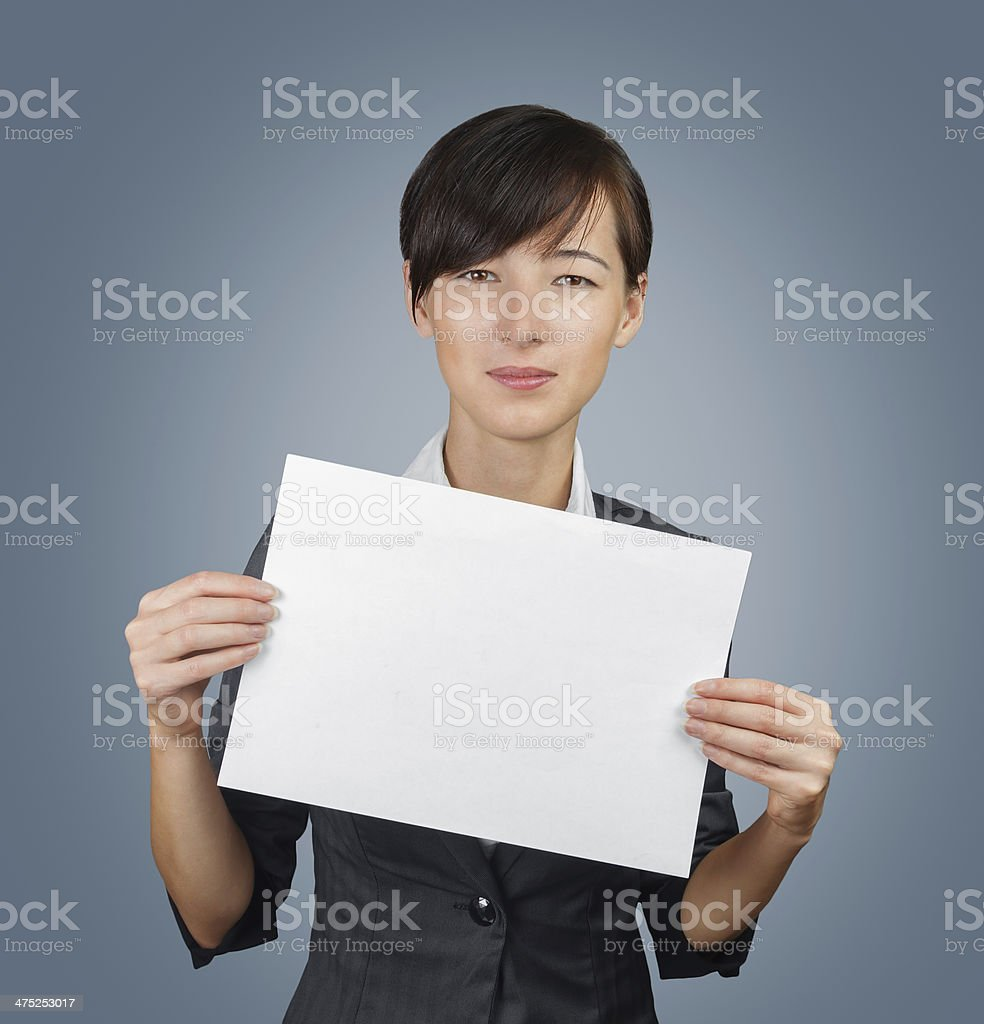 Woman holds a blank paper royalty-free stock photo