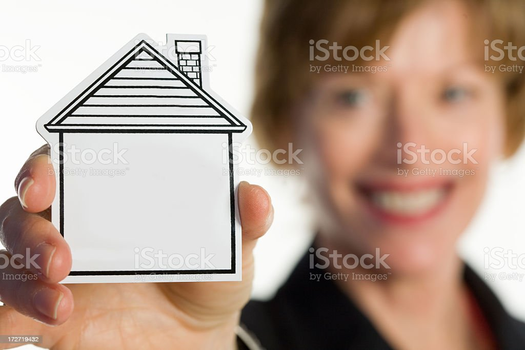 woman holds a home in her hands royalty-free stock photo