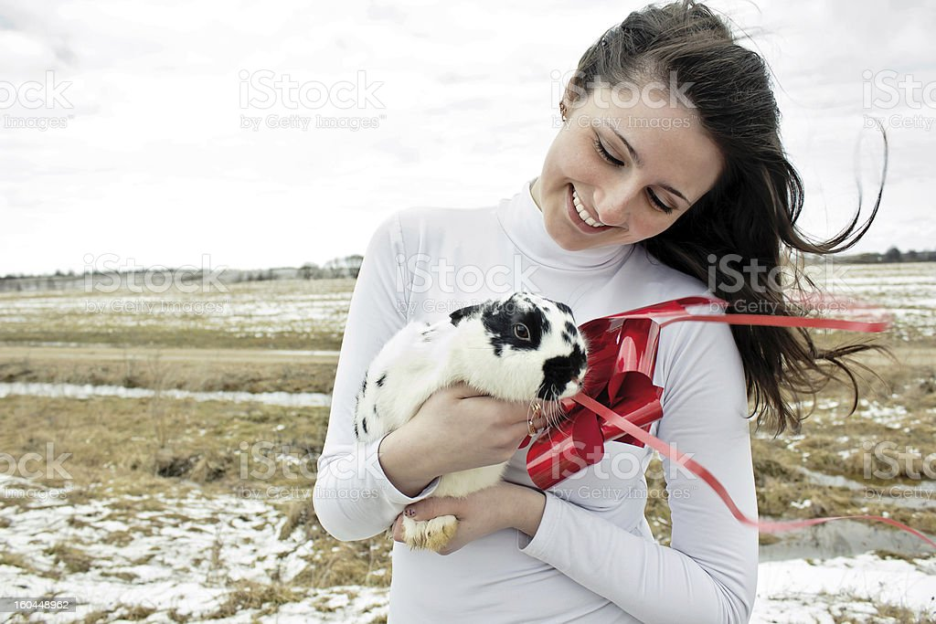 woman holds a rabbit in her arms royalty-free stock photo