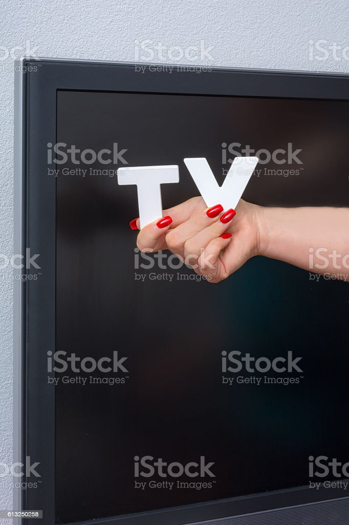 Woman holds a tv stock photo