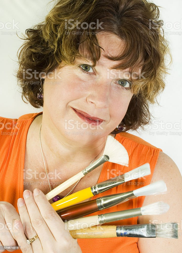 Woman Holds Artist Brushes royalty-free stock photo