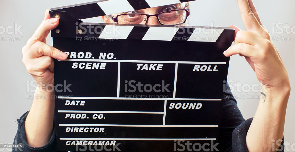 Woman holds film slate stock photo