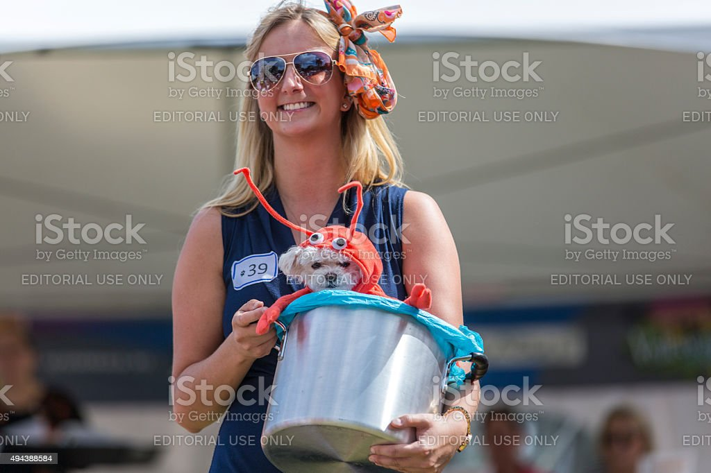 Woman Holds Her Dog a Lobster in a Pot stock photo
