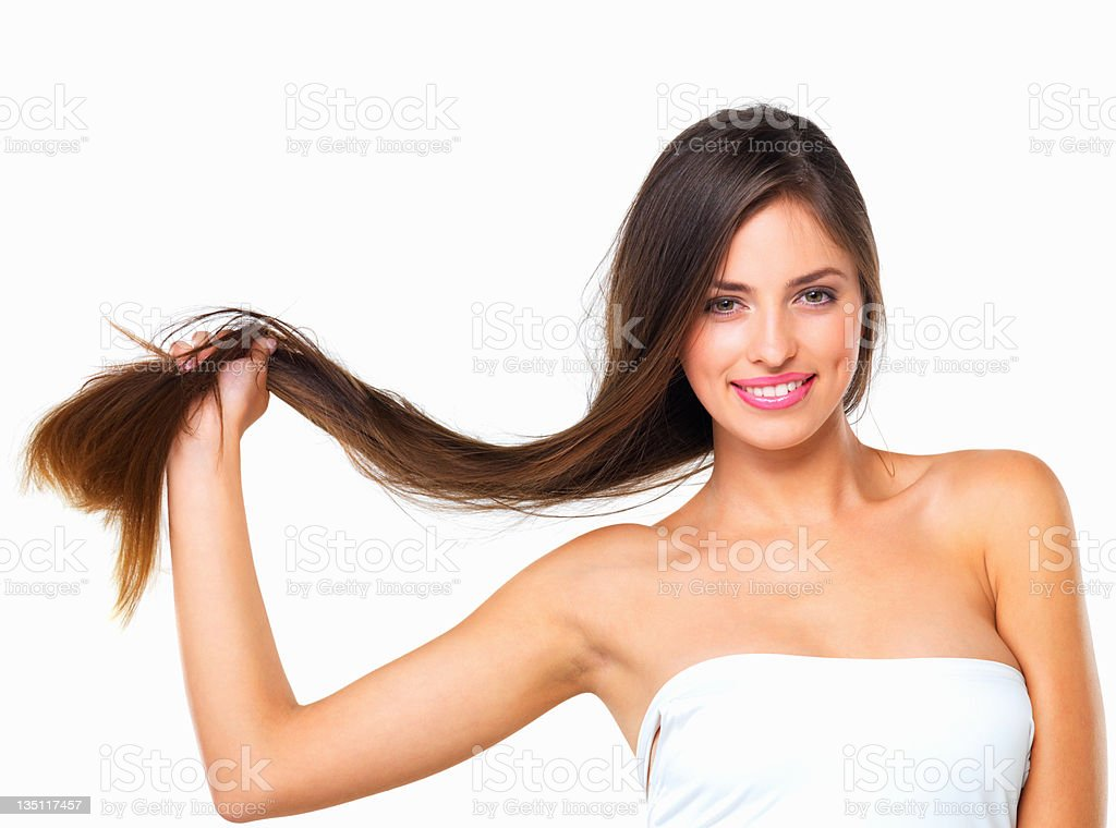 A woman holds her hair against a white background royalty-free stock photo